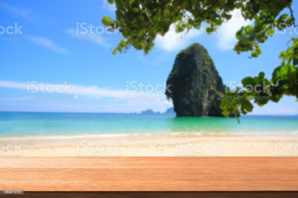 Wood table with blurred sea  background stock photo