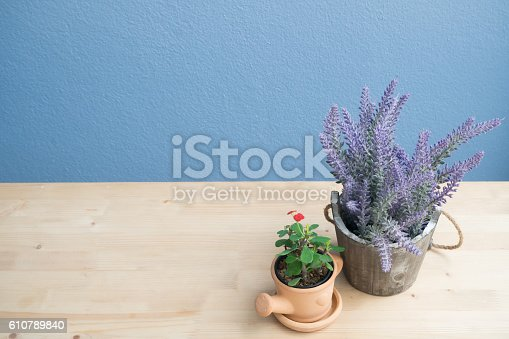 677933036 istock photo wood table with lavender flower  on flowerpot. 610789840