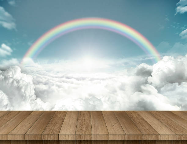 Wood table with rainbow stock photo
