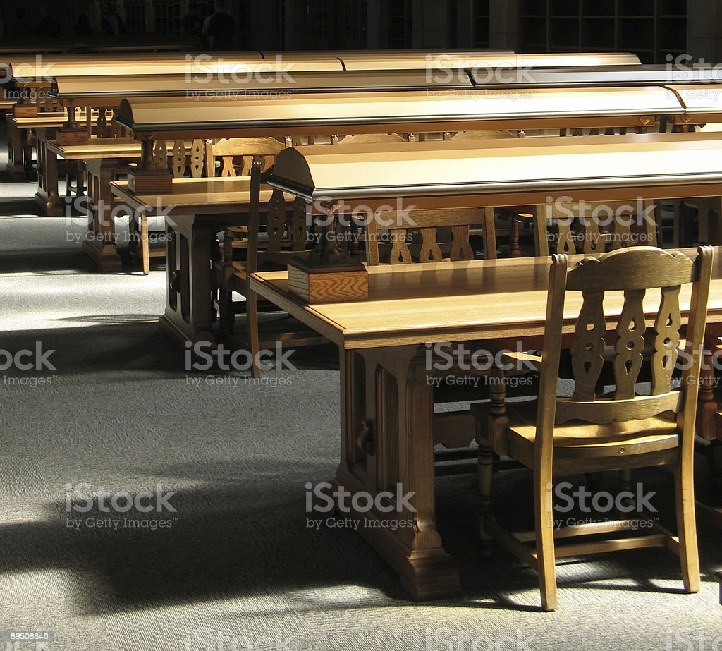 Wood tables and chairs in a library royalty-free stock photo