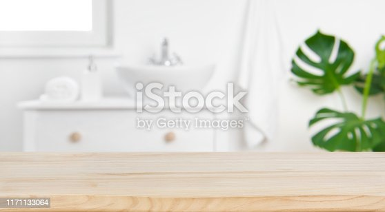 istock Wood tabletop on blur bathroom background, design key visual layout 1171133064