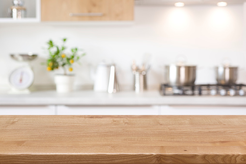Wood tabletop on blur kitchen counter background for product display