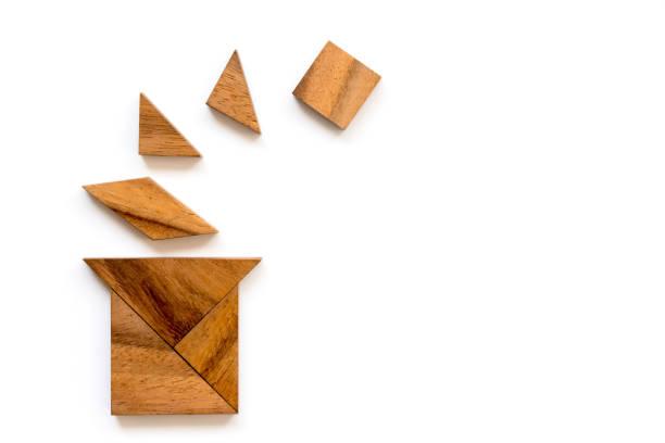 Wood tangram puzzle in magic hat shape on white background stock photo