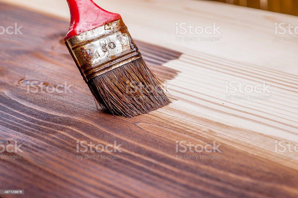 Wood texture and paintbrush stock photo