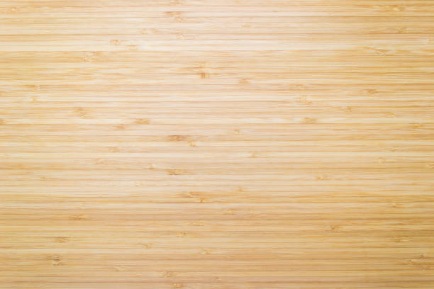 wood texture background in natural light yellow cream color - bambù materiale foto e immagini stock