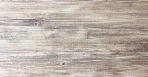 wood texture background, light oak of weathered distressed rustic wooden with faded varnish paint showing woodgrain texture. hardwood planks pattern table top view. - foto stock