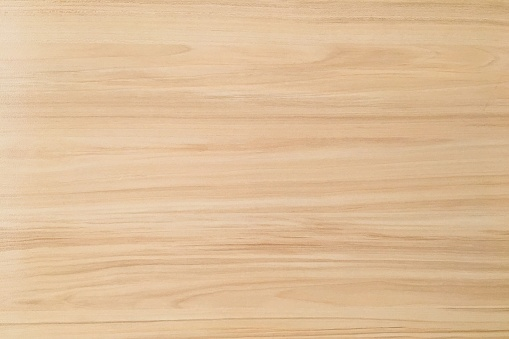 wood texture background, light weathered rustic oak. faded wooden varnished paint showing woodgrain texture. hardwood washed planks pattern table top view