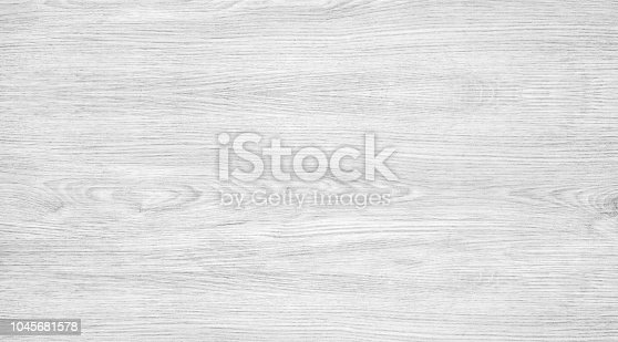 White wood texture background. Light wooden table with a crack. Surface of wood with nature color and pattern. Top view of a wood or plywood for backdrop.