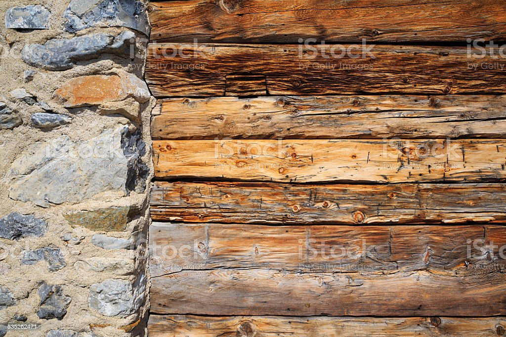 Wood texture background  Stone column  Wall detail of the facade stock photo
