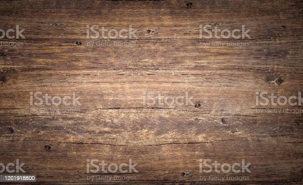 Photo of Wood texture background. Top view of vintage wooden table with cracks. Brown rustic rough timber for backdrop.