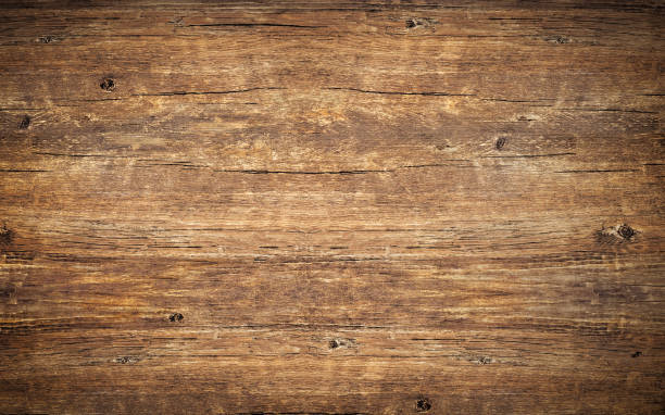 wood texture background. top view of vintage wooden table with cracks. surface of old knotted wood with natural color, texture and pattern. dark barn material. - ujęcie przedmiotu na stole zdjęcia i obrazy z banku zdjęć