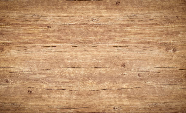 Wood texture background. Top view of vintage wooden table with cracks. Light brown surface of old knotted wood with natural color, texture and pattern. stock photo
