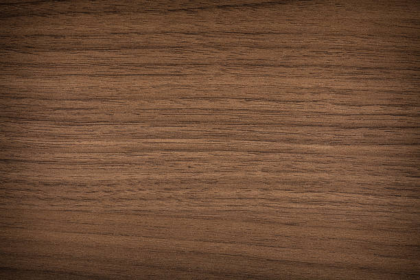Wood Texture - Full Frame A walnut wood texture background walnut stock pictures, royalty-free photos & images