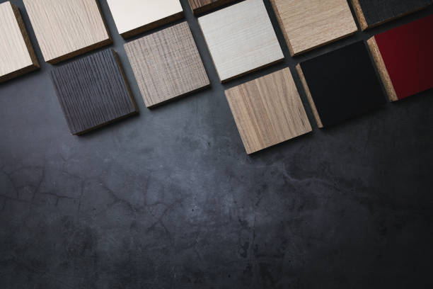 wood texture laminate furniture material samples on dark stone background with copy space stock photo