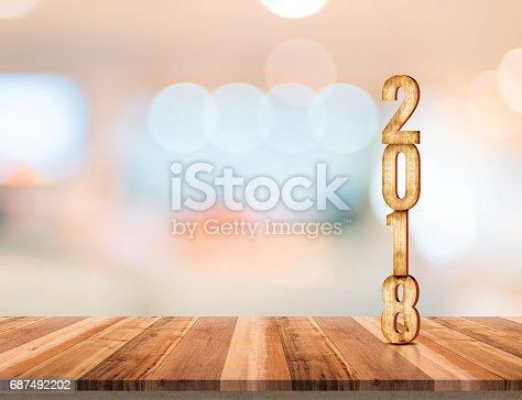 istock 2018 wood texture number on wood plank table top with blur abstract bokeh light background,Leave copy space for text or product,New year and Christmas holiday concept 687492202