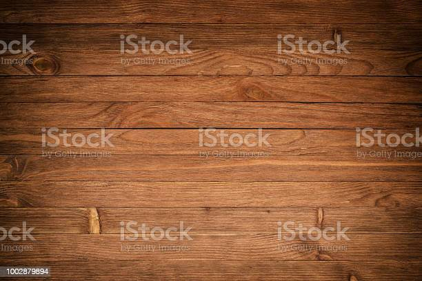 Photo of wood texture plank grain background, wooden desk table or floor, old striped timber board