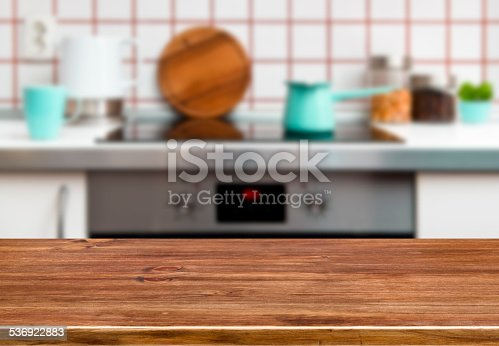 607472174istockphoto Wood texture table on kitchen stove bench background 536922883