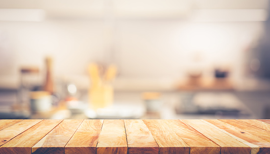 Wood texture table top (counter bar) with blur cafe, kitchen background.For montage product display or design key visual layout