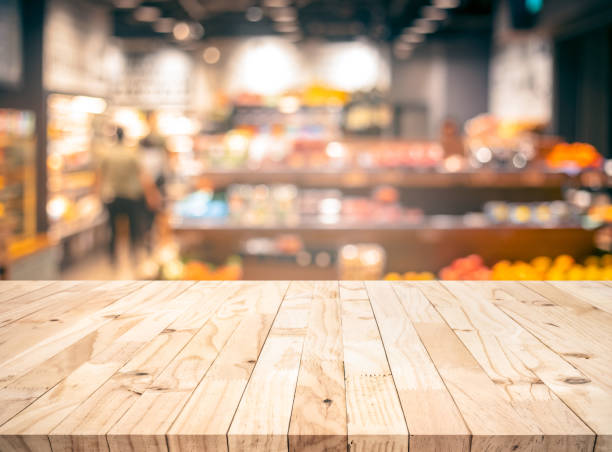 Wood texture table top (counter bar) with blur grocery,market store background stock photo