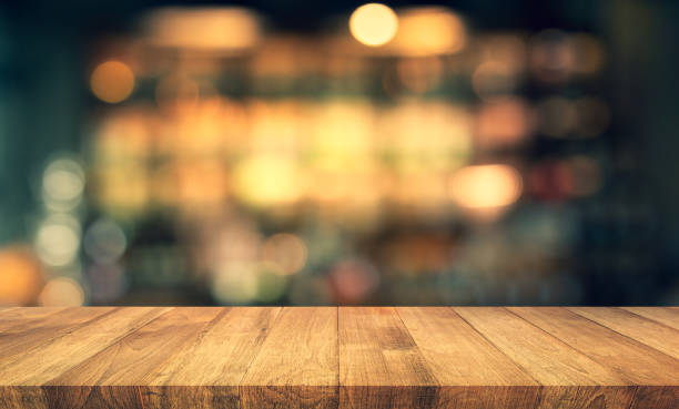 Wood texture table top (counter bar) with blur light gold bokeh in cafe,restaurant background stock photo
