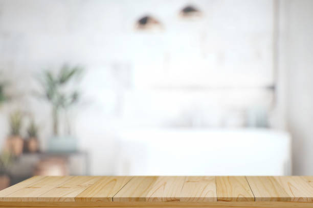 Wood top table with white blurred bathroom interior Background. for product display montage. Wood top table with white blurred bathroom interior Background. for product display montage. empty desk stock pictures, royalty-free photos & images