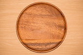 wood tray on table background