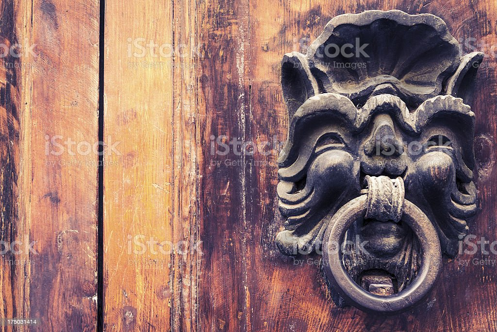 Wood Vintage Ornated Door with Iron Gargoyle Handle stock photo