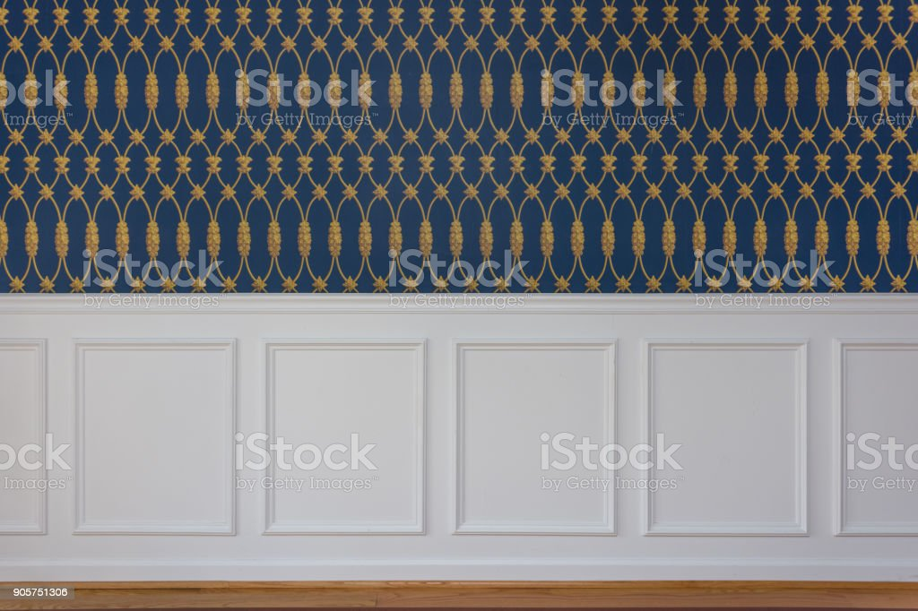 Wood wall paneling and elegant wall paper stock photo
