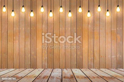 istock wood wall with bulb lights lamp. 648499744