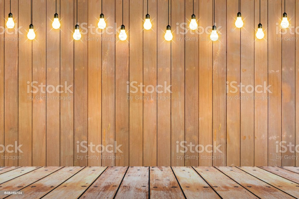 wood wall with bulb lights lamp. stock photo