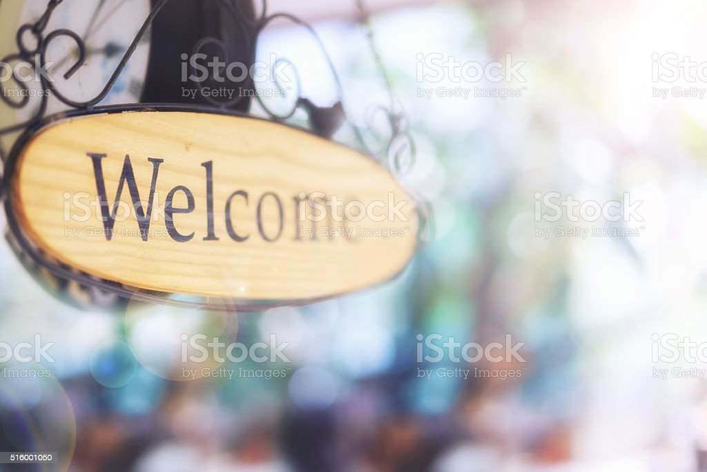 wood welcome sign hanging. selective focus stock photo