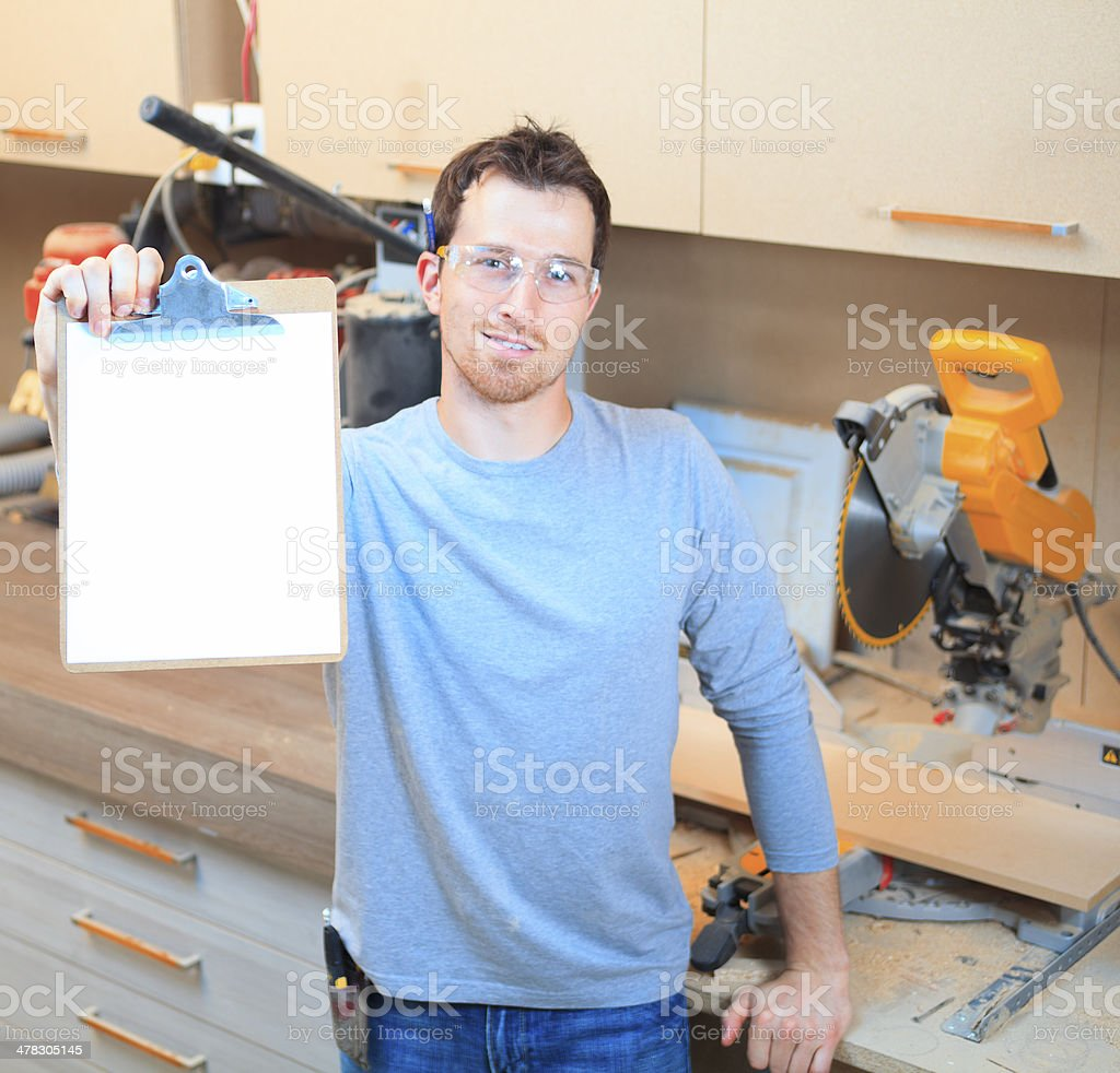 Wood Worker - Holding White Pad royalty-free stock photo