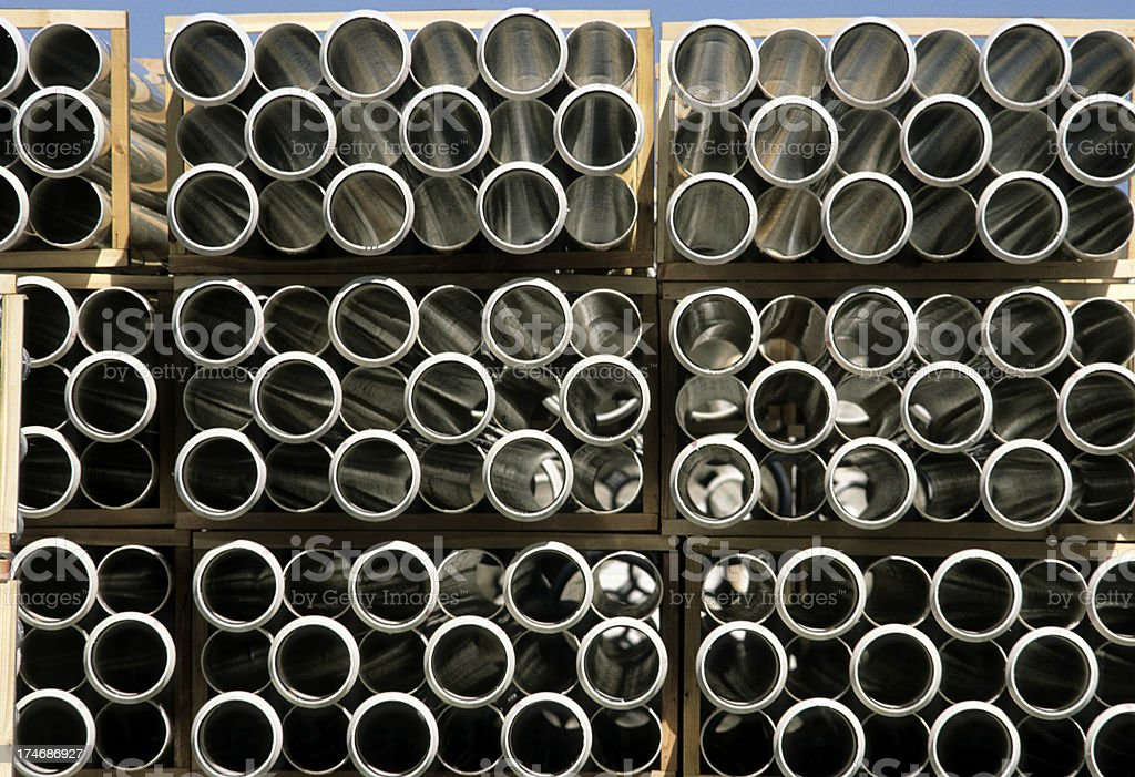 Wood-crated extruded plastic storm-drain pipes ready for shipment royalty-free stock photo