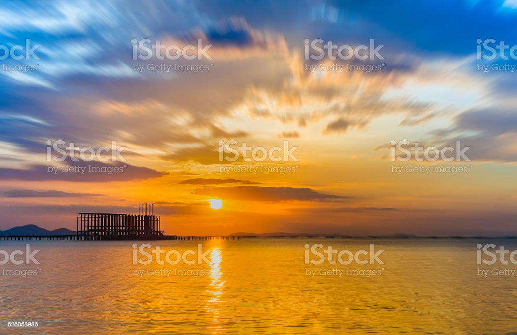 Wooded bridge in the port and sunset stock photo