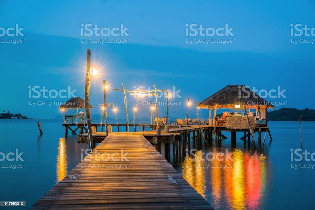 Wooded bridge to Koh Mak harbor after sunset stock photo