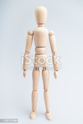 Woodem man figure isolated on the white background.