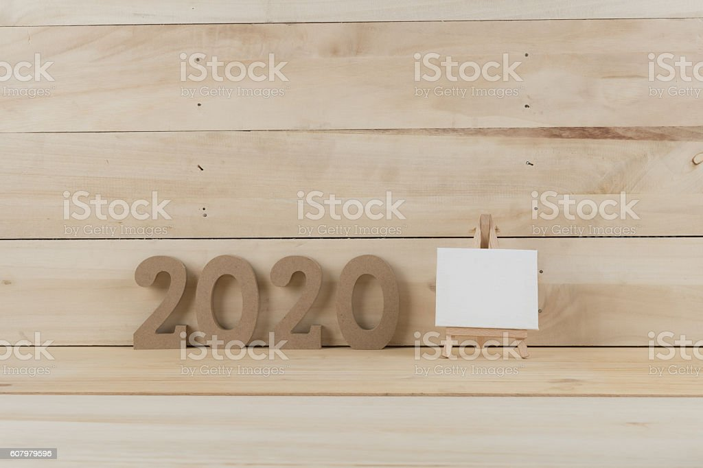 Wooden 2020 year number on wooden background stock photo