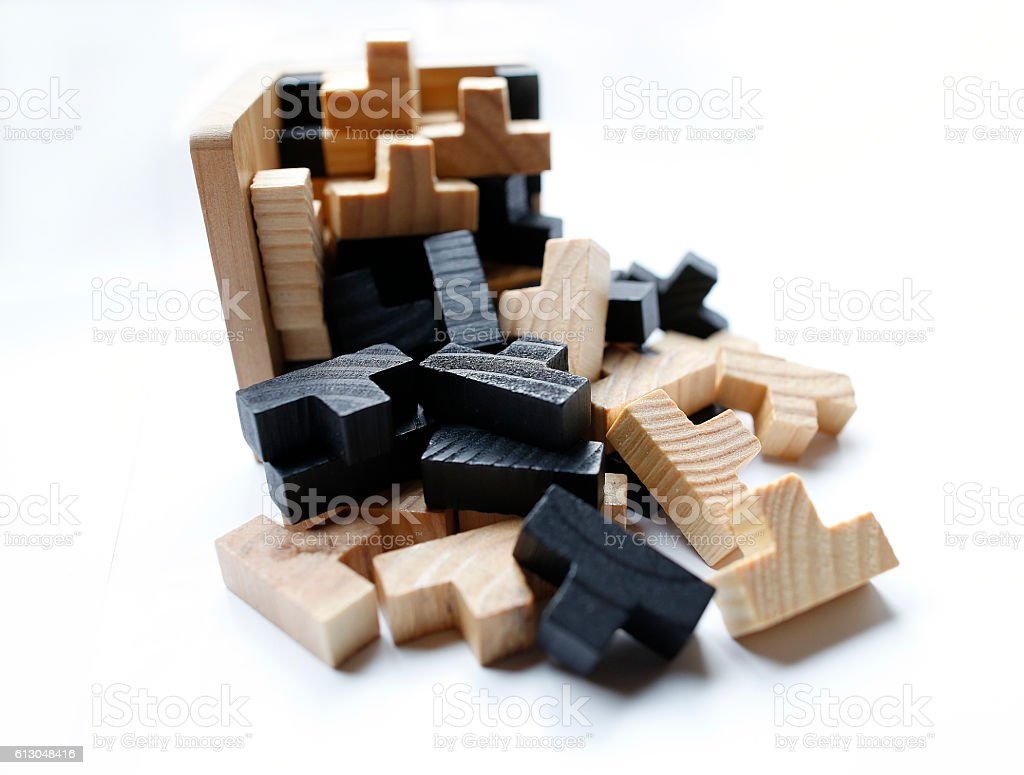Wooden 3D puzzle blocks on white background stock photo