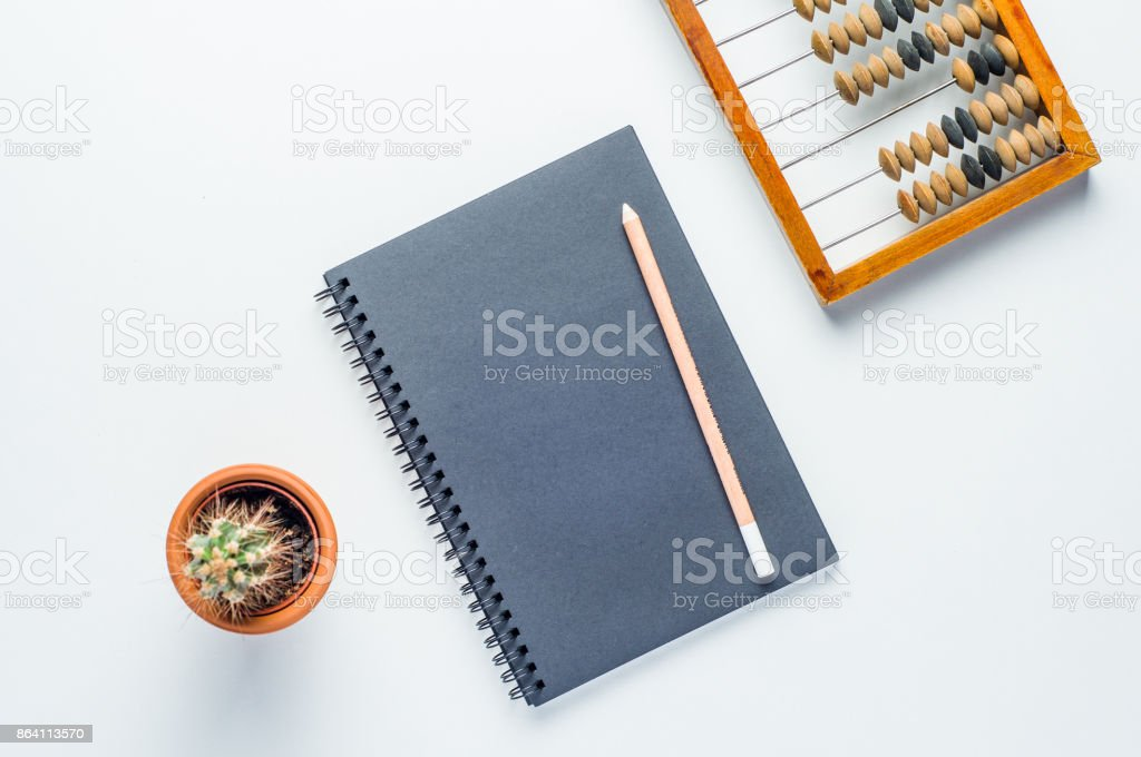 Wooden abacus and black notebook on white background - foto stock