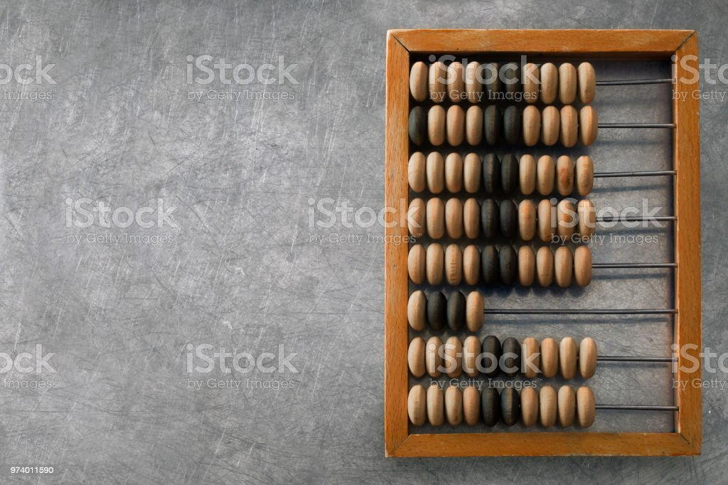 wooden abacus on a metal surface stock photo