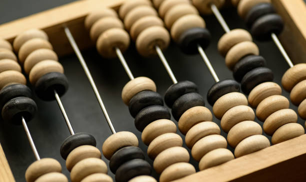 Wooden abacus. Old wooden abacus on dark background. abacus stock pictures, royalty-free photos & images