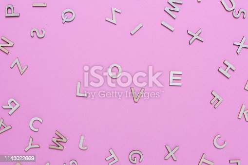 613303142 istock photo Wooden ABC alphabet letters on pink background 1143022669