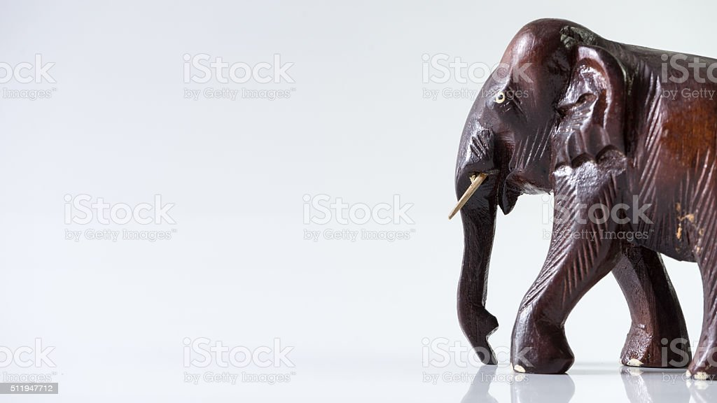 Wooden adult male elephant with trunks stock photo