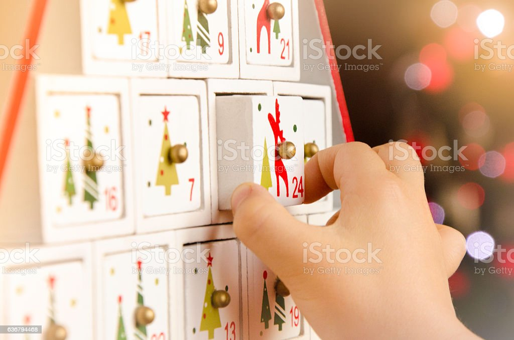 Wooden advent calendar Christmas tree and child stock photo