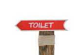 istock Wooden allow pointer toilet sign for background 620731630