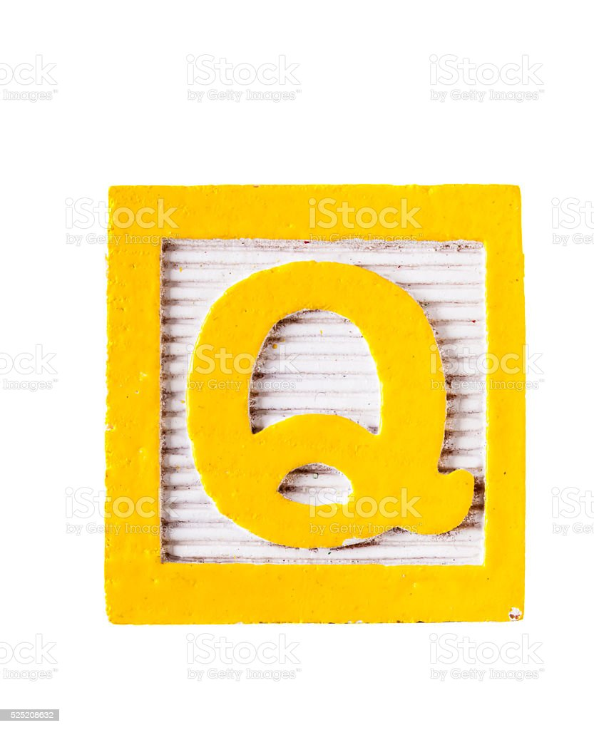 Wooden alphabet block with letter Q  isolated on white stock photo