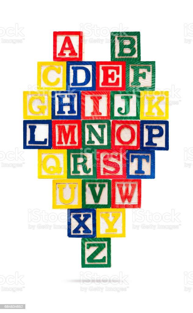 Wooden alphabet blocks isolated on white background stock photo