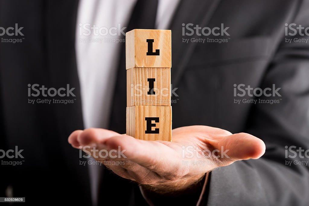 Wooden alphabet blocks reading Lie stock photo