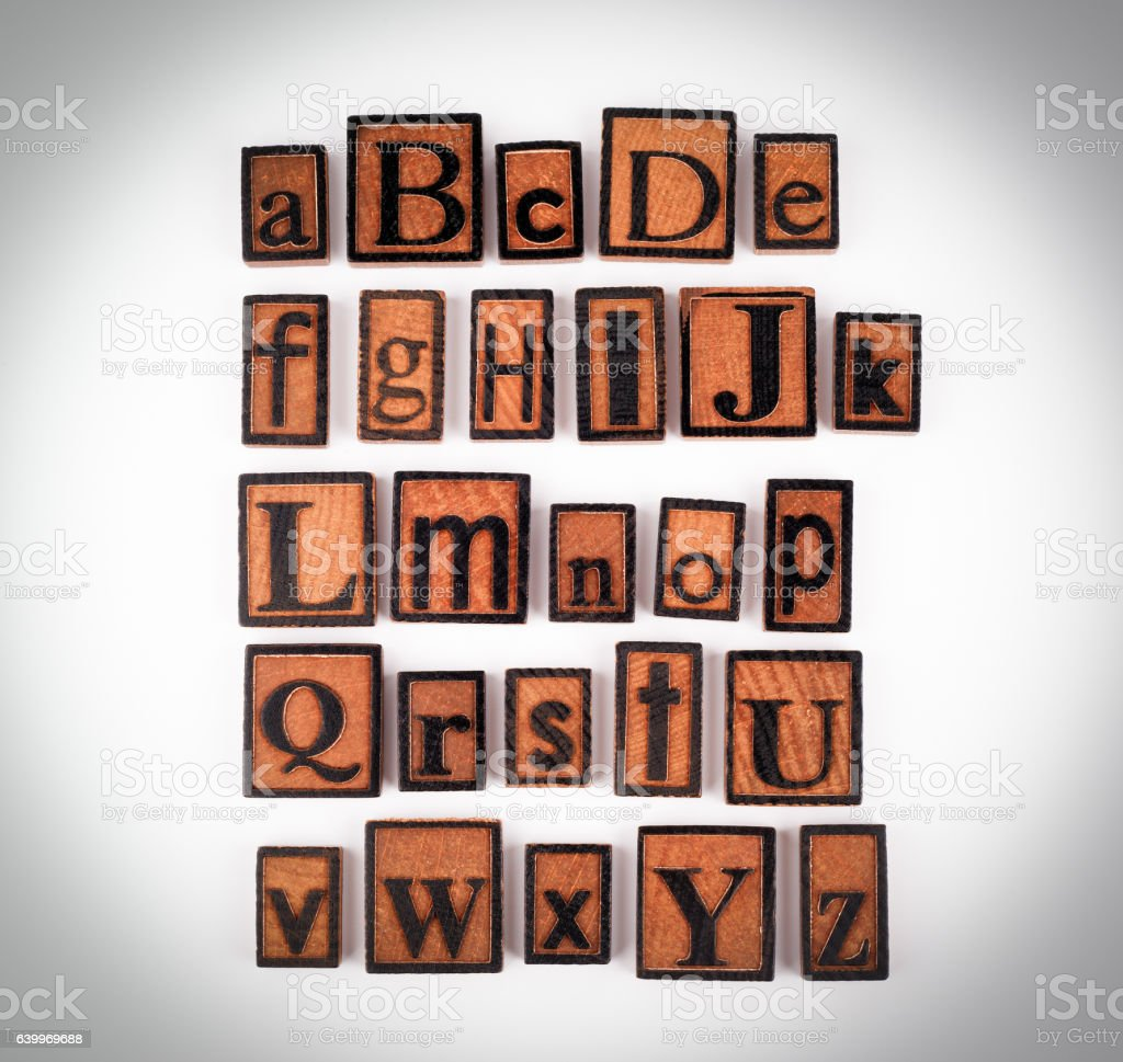 Wooden alphabet letters on a white background stock photo