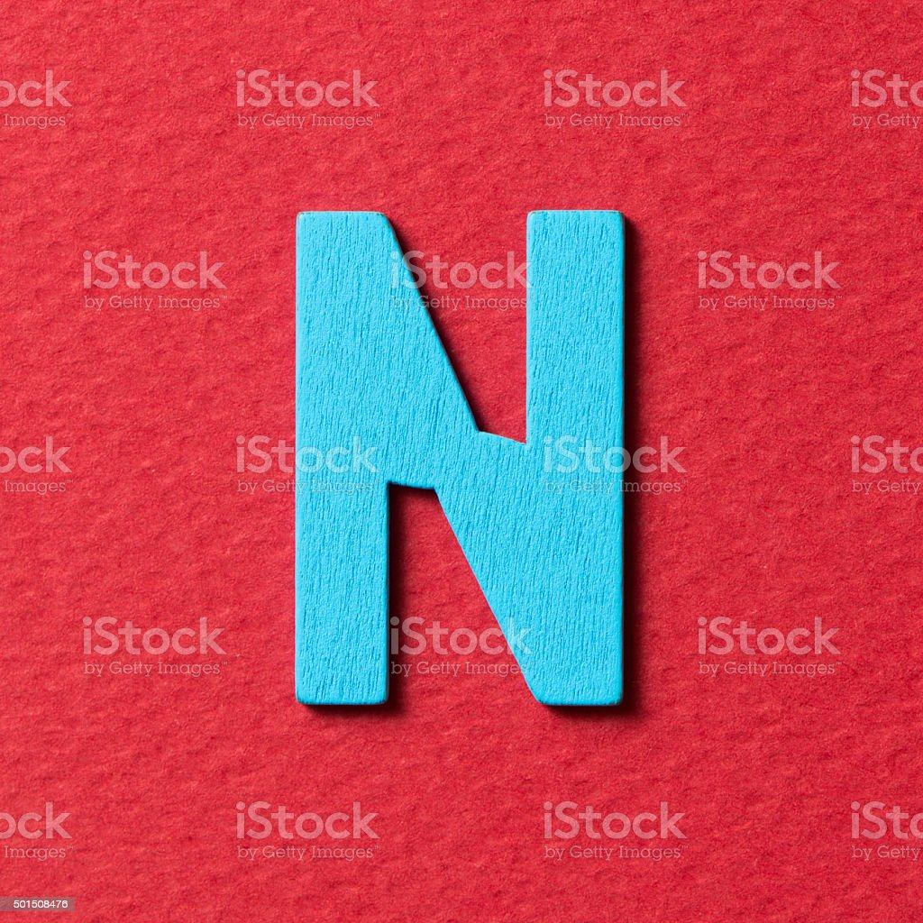 Wooden alphabet N in capital letter stock photo